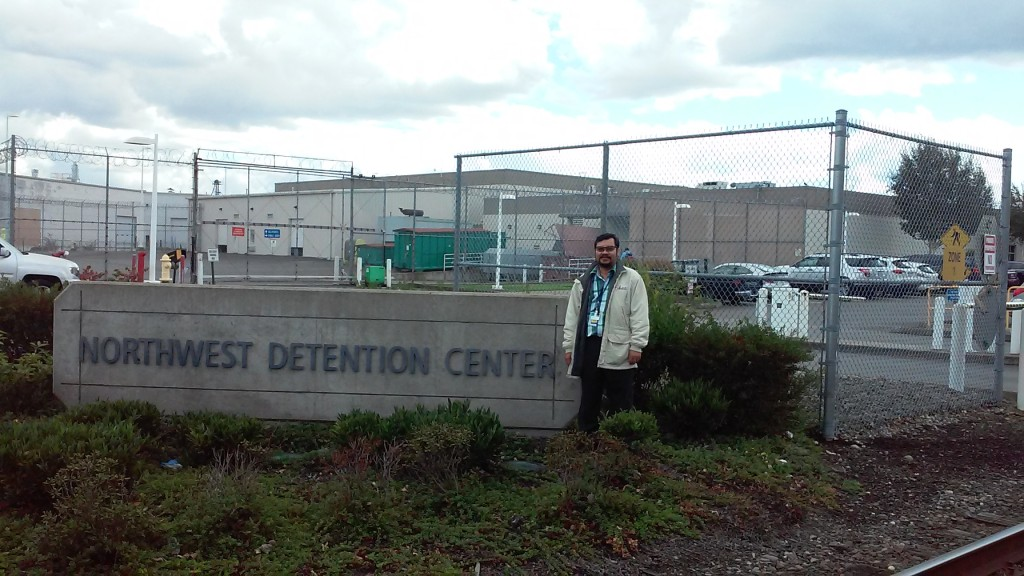 pastor in front of detention center